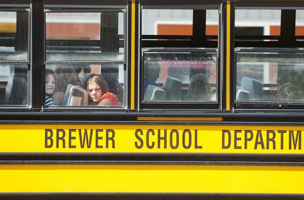 Students gaze out windows as the buses at Brewer High School prepare to leave at the end of the first day of school, in this 2010 file photo. (BANGOR DAILY NEWS PHOTO BY BRIDGET BROWN)
