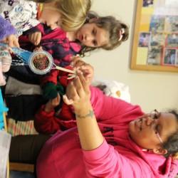 Jaclyn Sockbeson demonstrating beadwork.