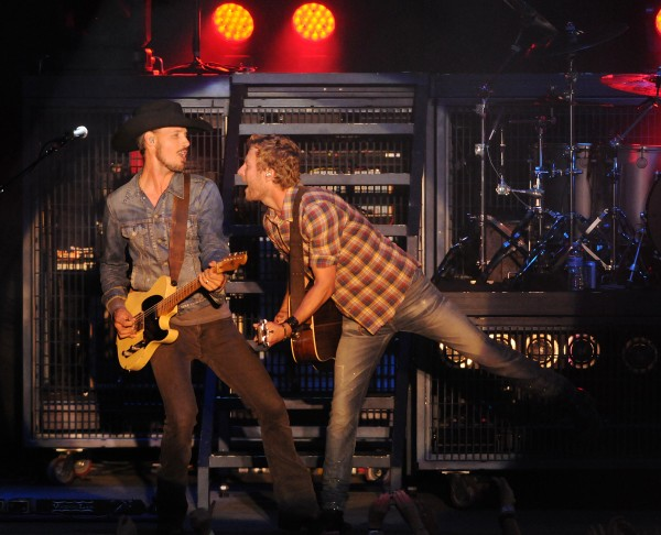 Dierks Bentley, right, performs onstage at the Darlings Waterfront Pavilion on Friday.