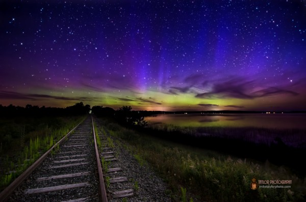 Blue Aurora Spikes over railroad tracks in Unity, Maine.