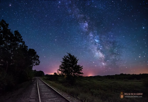 The Milky Way over railroad tracks.
