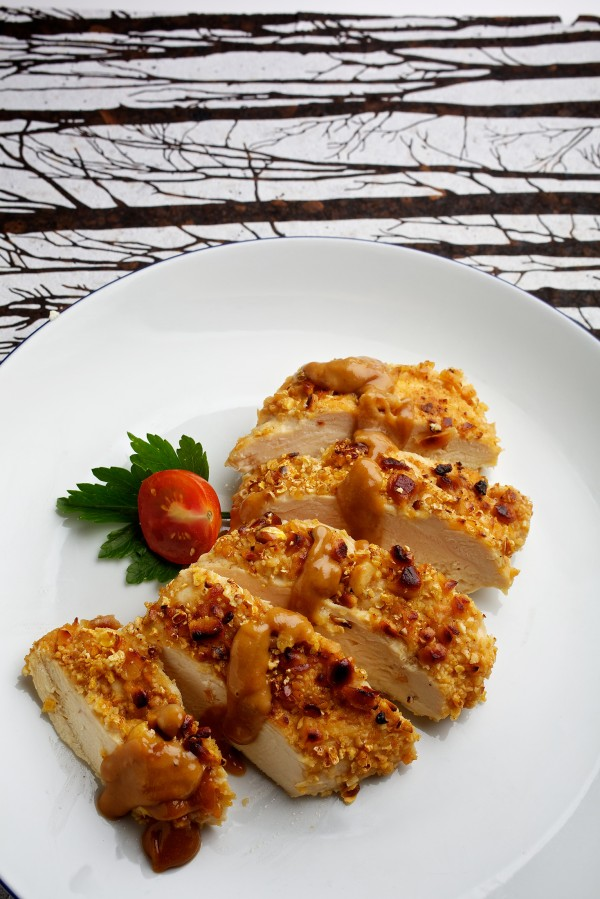 Thai Popcorn-and-Peanut-Crusted Chicken. The classic pairing of popcorn and peanuts provides a crunchy topping.