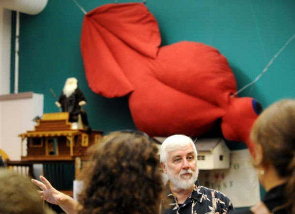 Loren Coleman explains the International Cryptozoology Museum in Portland to visitors from Buffalo, N.Y., under a colossal squid constructed by artist Sarah McCann. The squid's dimensions match a real animal found off New Zealand in 2007.