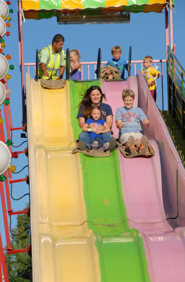Everyone smiles as they zip down the giant slide at the 125th Annual Piscataquis Valley Fair, which runs through Sunday at the Piscataquis Valley Fairgrounds in Dover-Foxcroft.