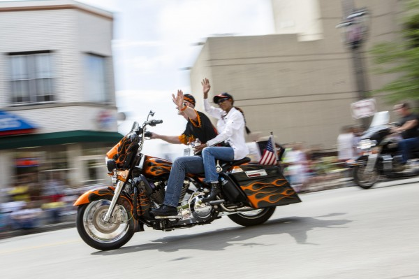 Harley riders wave during the Harley Davidson 110th Anniversary Celebration parade in Wisconsin Avenue, Milwaukee August 31, 2013. Tens of thousands of Harley-Davidson enthusiasts from all corners of the globe make the pilgrimage to Milwaukee for the motorcycle maker's 110th anniversary celebration over the Labor Day weekend.