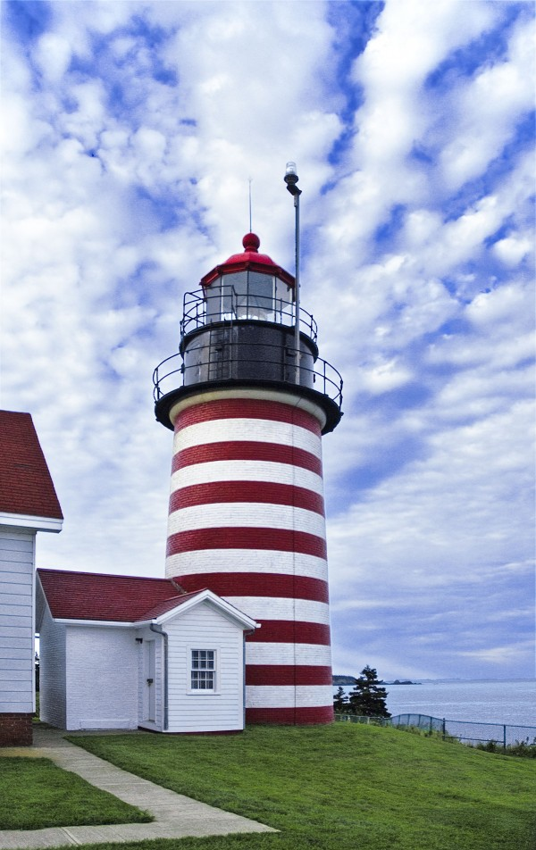 The red and white horizontal stripes of West Quoddy Head Lighthouse are a familiar and comforting sight to passing ship traffic.