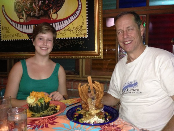 Tessa Wood with her Dad (who is about to tackle a crab dish called &quotGodzilla&quot) at &quotJacques-Imo's&quot Restaurant in New Orleans.