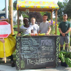 School Garden Army selling their weekly harvest at their farm stand near Oceanside East High School.