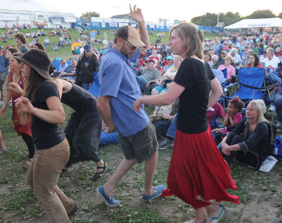 American Folk Festival goers dance to the sounds of Jorge Arce and Raiz de Plena as the the American Folk Festival gets under way on Friday along the Bangor Waterfront.