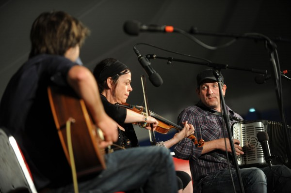 The Irish trio of McAuley, Horan and O'Caoimh play to a full house at the Penobscot stage American as the the American Folk Festival gets under way on Friday along the Bangor Waterfront.