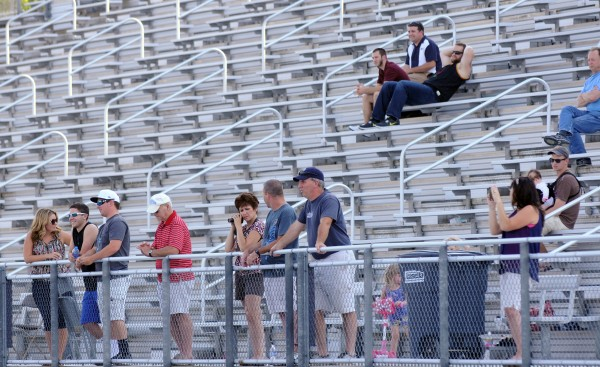 Family members and friends of UMaine football players watch from the stands during the Blue/White scrimmage on Tuesday at Morse Field on the UMaine campus in Orono.