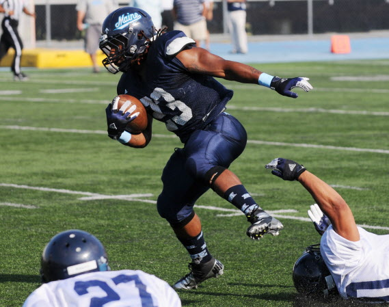 The University of Maine's Terrell Walker breaks a tackle during a Blue-White scrimmage on Tuesday at Alfond Stadium in Orono.