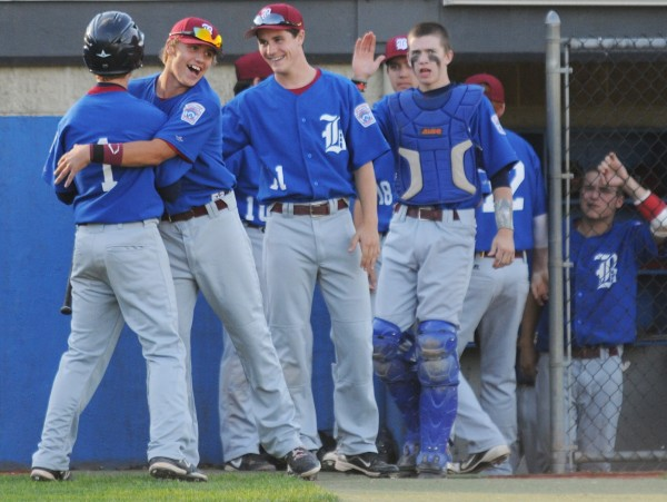 Bangor celebrates a run during sixth-inning action against Hampden during the District 3 Senior League championship at Mansfield Stadium on Tuesday night.
