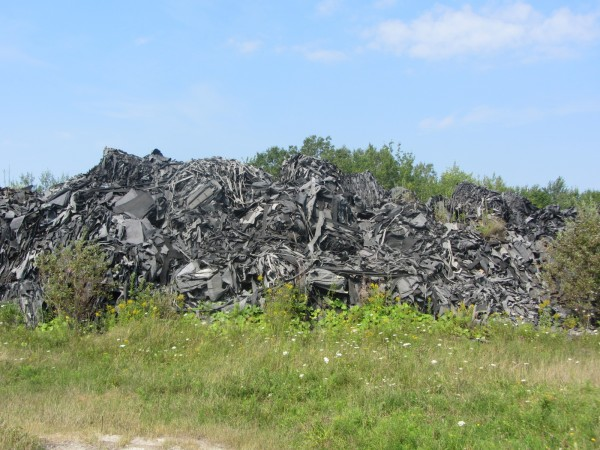 This is one of the piles of fiber material stored on 70 acres in Warren at a former rifle range.