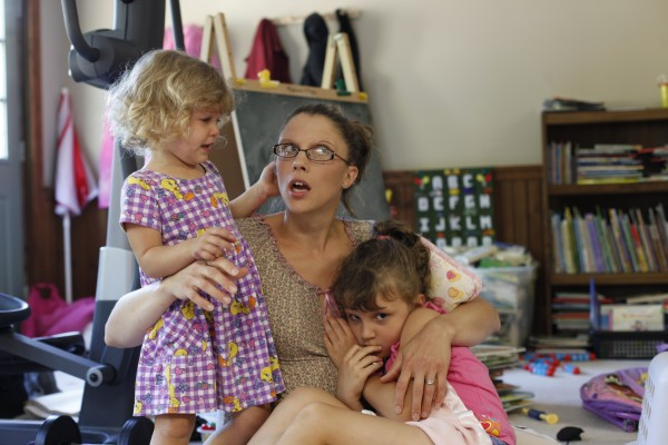 Crystal Stanley sits with two of her seven children at the family's home in Lincoln, Maine.