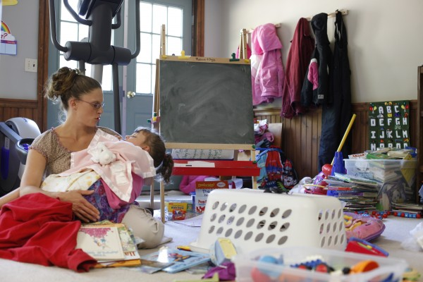 Crystal Stanley sits with one of her seven children at the family's home in Lincoln, Maine.