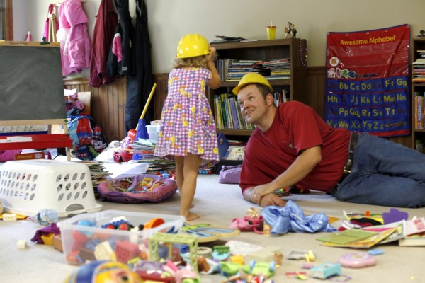 Joel Stanley plays with Olivia, 3, one of his seven children at the family's home in Lincoln, Maine.