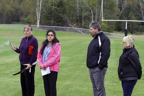 The Houlton Band of Maliseets unveiled their new sports complex with a blessing ceremony on Sept. 23 prior to the start of a Houlton varsity football game against Old Town. Houlton won 21-0. Taking part in the blessing ceremony are (from left) Dayna Boyce, tribal member; Brenda Commander, tribal chief; Mike Hammer, RSU 29 superintendent; and Rosa McNally, grant writer for the tribe.