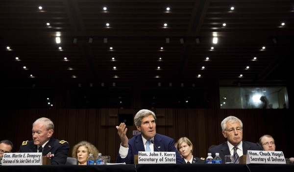 Chairman of the Joint Chiefs General Martin E. Dempsey (L), John Kerry, U.S. Secretary of State (C), and Chuck Hagel, Secretary of Defense, present the administration's case for U.S. military action against Syria to a Senate Foreign Relations Committee hearing in Washington, September 3, 2013. President Barack Obama on Tuesday urged quick congressional action authorizing the use of military force against Syria and won the support of leaders from both parties in the House of Representatives for limited strikes against President Bashar al-Assad's forces.