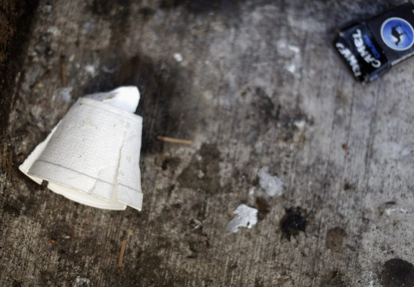 A crushed Styrofoam coffee cup lies on the ground in New York, February 15, 2013.