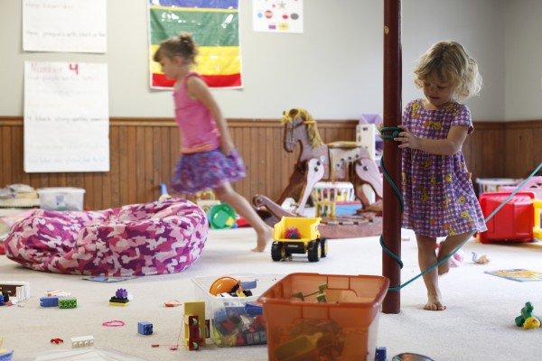 Two of the seven Stanley children play in the family's basement in Lincoln, Maine. Crystal and Joel Stanley have seven children including three sets of twins.