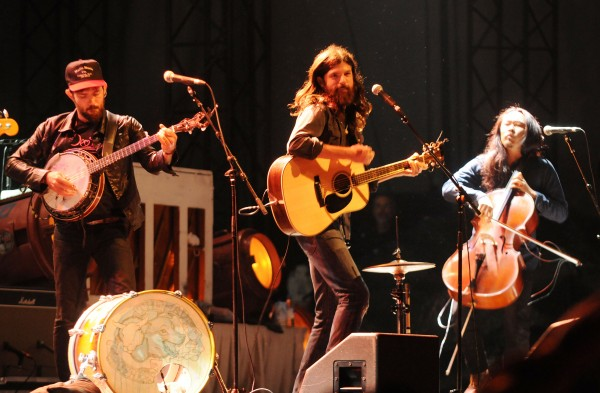 Scott Avett, Seth Avett and Joe Kwon of The Avett Brothers perform on a rain soaked Darling's Waterfront Pavilion stage on the Bangor Waterfront on Friday night.