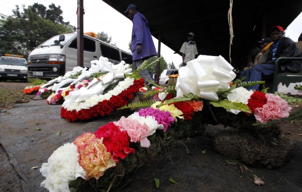 Flower wreaths are displayed for sale outside the City Mortuary, for the victims who were killed during the attack at the Westgate Shopping Centre in Kenya's capital Nairobi, September 25, 2013. As Kenya began three days of mourning on Wednesday for at least 67 people killed in the siege of a Nairobi mall, it was unclear how many more hostages may have died with the Somali Islamist attackers buried in the rubble.