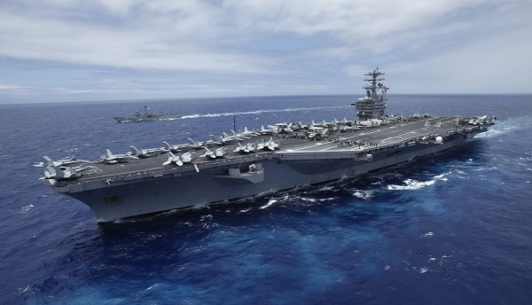 The USS Nimitz, a nuclear-powered aircraft carrier which is currently supplemented by biofuel, sails about 150 miles north of the island of Oahu during the RIMPAC Naval exercises off Hawaii in this file photo from July 18, 2012. The Nimitz and four other ships in its strike group moved into the Red Sea early September 1, 2013, U.S. defense officials said, describing the move as &quotprudent planning&quot in case the ships are needed for military action against Syria.