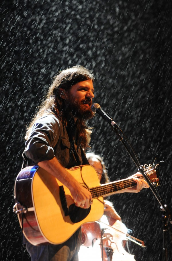 Seth Avett of the Avett Brothers performs on a rain-soaked Darling's Waterfront Pavilion stage on the Bangor Waterfront on Friday night.