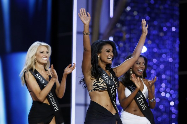 Miss America 2014 contestant, Miss New York Nina Davuluri (C) reacts as she is chosen to move on while competing in the Miss America Pageant in Atlantic City, New Jersey, September 15, 2013.
