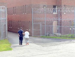 "A prisoner is brought down the ""runway"" into one of the buildings on the sprawling complex at the Maine Correctional Center in Windham."