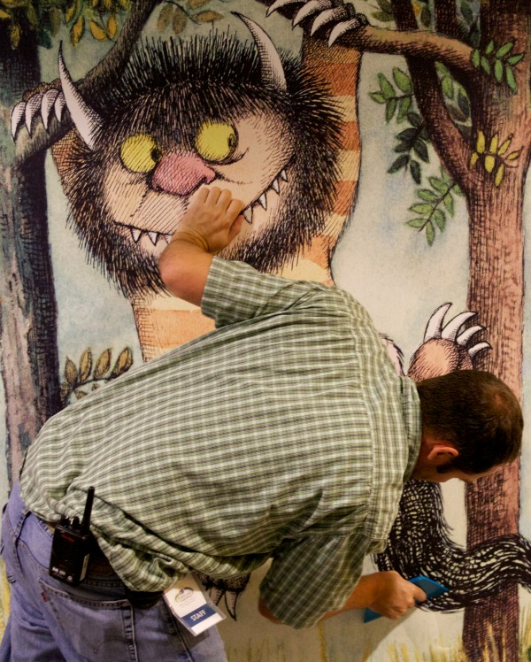 Maintenance and Security Supervisor Paul Tetzlaff smooths out a large print of a familiar Maurice Sendak character at the Portland Public Library on Thursday. From Sept. 6 to Oct. 25, the Maine College of Art and the library is presenting a special exhibition called &quotMaurice Sendak: 50 Years, 50 Works, 50 Reasons.&quot The exhibition includes 50 original works from Where the Wild Things Are in a variety of mediums including sketches, illustrations, and works on paper, and showcases highlights from Sendak's career and the diverse art forms.