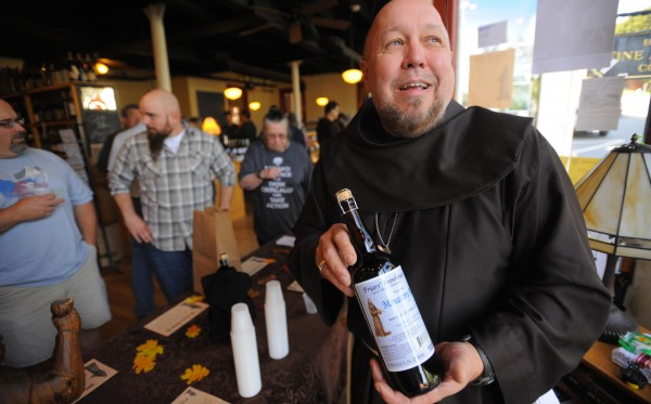 Brother Don holds up a bottle of beer that was made by the Franciscan Friars. The first bottle of the brew went up for sale at the Bangor Wine and Cheese Company Sunday.  They held a raffle to determine who will get to buy the first ten bottles of the craft beer made by the new Friars' Brewhouse.