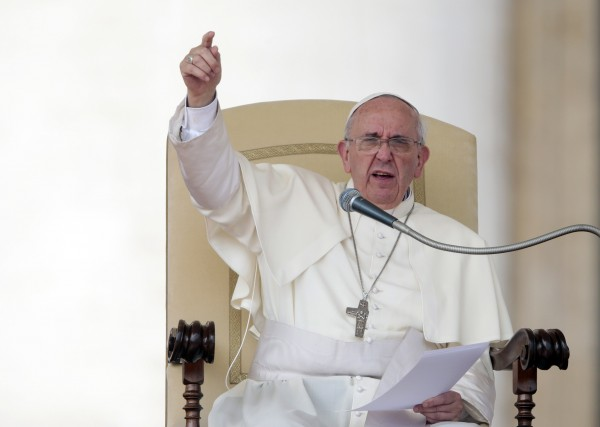 Pope Francis gestures as he leads his Wednesday general audience in Saint Peter's Square at the Vatican in this September 11, 2013 file photo. Pope Francis said the Catholic Church must shake off an obsession with teachings on abortion, contraception and homosexuality and become more merciful or risk the collapse of its entire moral edifice &quotlike a house of cards&quot.