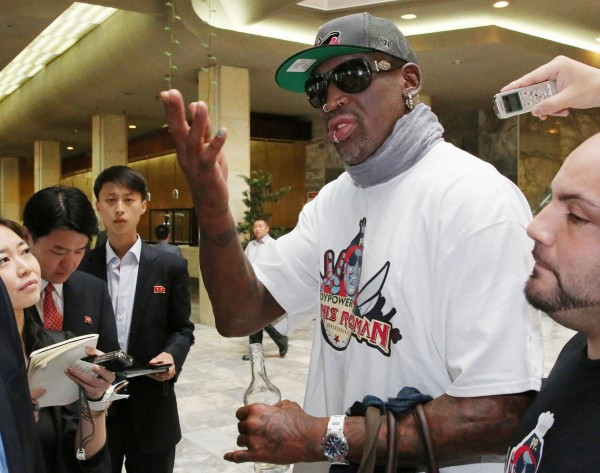 Former basketball star Dennis Rodman answers a reporter's question at a hotel in Pyongyang, in this photo taken by Kyodo September 7, 2013.