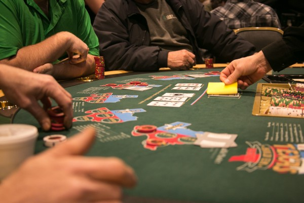 Patrons play Texas hold 'em poker at the Hollywood Casino on Friday, March 15, 2013.