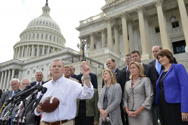 U.S. Representative Tim Griffin (R-AR), holds a football as he joins a Republican Congressional rally, at the U.S. Capitol, in Washington, September 29, 2013, as a possible government shutdown looms in two days. Griffin used the football to say the Democratic Senate refuses to &quotplay ball&quot after the House passed a bill which President Barack Obama called unacceptable. Without agreement, the government faces its first shutdown in 17 years.