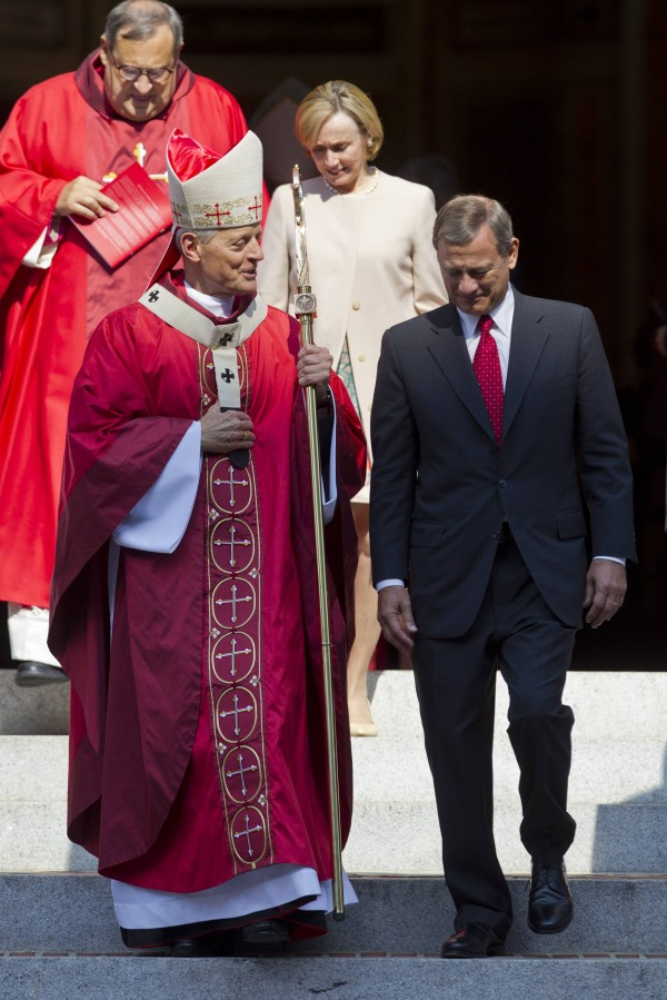 Cardinal Donald Wuerl, Archbishop of Washington, (L) and Supreme Court Chief Justice John G. Roberts talk as they exit the annual Red Mass held at the Cathedral of St. Matthew the Apostle in Washington September 30, 2012.