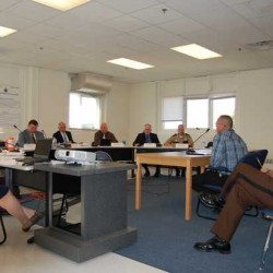 Franklin County Detention Center Manager Doug Blauvelt, sitting at table, answers questions Tuesday from the state Board of Corrections prior to the board voting not to reopen the jail to full service. Franklin County Sheriff Scott Nichols Sr. listens at right.