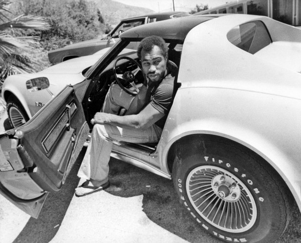 In a file image from June 25, 1976, Ken Norton shows off his sports car at his training camp in Gilman Hot Springs, California. Norton, the former heavyweight champ, died on Wednesday, September 18, 2013; he was 70.