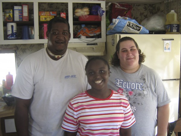 Adopted child Quita Puchalla is pictured with adoptive parents Calvin and Nicole Eason at the Eason's trailer in Tilton, Illinois, in this undated family photograph.