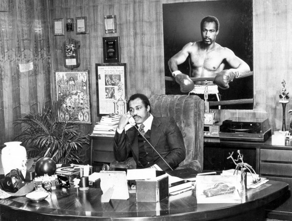 In a file image from January 22, 1980, Ken Norton works the phones in his business office. Norton, the former heavyweight champ, died on Wednesday, September 18, 2013; he was 70.