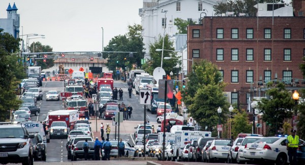 Emergency vehicles stand by on M St. SE in Washington, D.C., near the scene where 13 people were killed