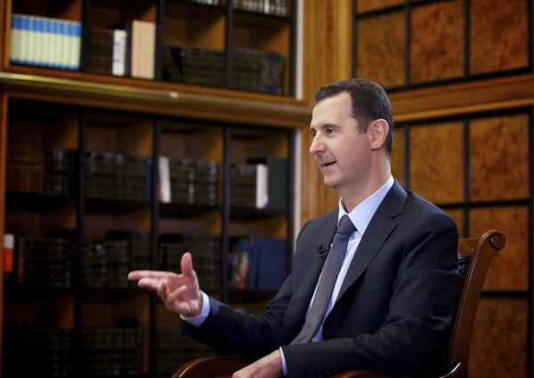 Syria's President Bashar al-Assad speaks during an interview with Russian state television RU24 in Damascus in this September 12, 2013 file handout photo by Syria's national news agency SANA.