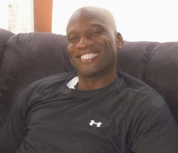 Aaron Alexis, who the FBI believe to be responsible for the September 16, 2013 shootings at the Washington Navy Yard in Washington, D.C., is shown in this undated handout photograph provided by Kristi Suthamtewakul, wife of &quotHappy Bowl&quot Thai restaurant owner Nutpisit Suthamtewakul, who was best friends with Alexis when he lived in White Settlement, Texas.