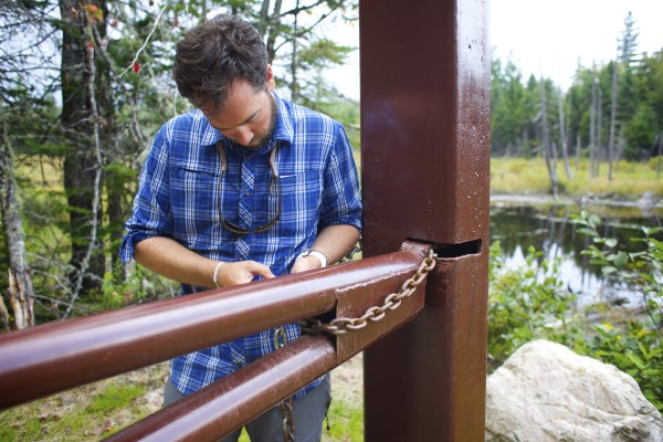 Lucas St. Clair unlocks a gate onto Elliotsville Plantation Inc. property that is opening 40,000 acres to hunting and other recreational use.