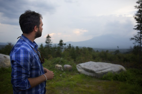 Lucas St. Clair looks toward Mt. Katahdin at a lookout where Elliotsville Plantation Inc. has opened 40,000 acres to hunting and other recreational use.