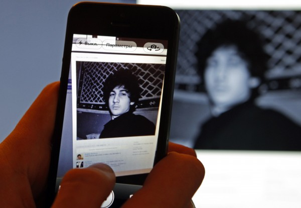 A photograph of Dzhokhar Tsarnaev, a suspect in the Boston Marathon bombing, is seen on his page of Russian social networking site Vkontakte (VK), as pictured on a monitor and a mobile phone in St. Petersburg in this April 19, 2013, file photo.