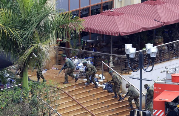 Kenya Defence Forces soldiers take their position at the Westgate shopping center, on the fourth day since militants stormed into the mall, in Nairobi September 24, 2013. Somalia's al Shabaab Islamist group said on Tuesday there were &quotcountless dead bodies&quot in the Westgate shopping centre as security forces searched for militants still holed up in the complex after a weekend attack that authorities say killed 62 people.