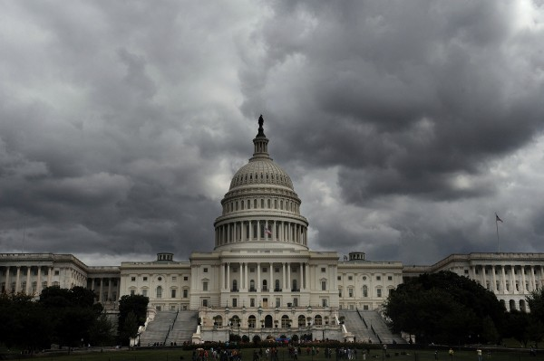 The U.S. Capitol appears under cloudy skies in Washington, D.C., Saturday, September 28, 2013. House Speaker John Boehner's plan to avert a shutdown by shifting to a debt-ceiling fight ran into opposition from some Republicans in another setback for efforts to keep the U.S. government operating after September 30.